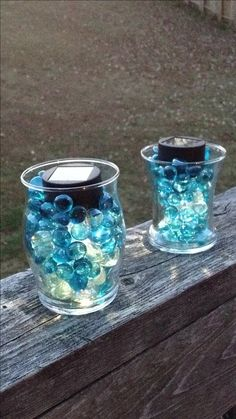 Take a used candle jar, an outdoor solar light and glass beads. It's a great outdoor decoration for patio railings.  I LOVE this idea!  This can be accomplished very inexpensively too...you can buy most of the things needed in your local dollar store!