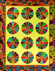 """""""Wagon Wheels"""" is featured in the """"Flip & Fuse Quilts"""" book by Marcia Harmening of Happy Stash Quilts with C&T Publishing."""