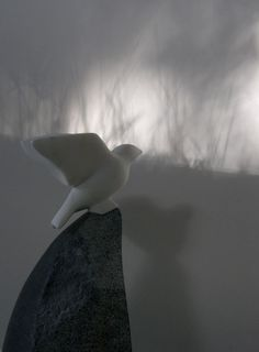 Carrara marble. granite Primitive Naive sculpture statue carving casting sculpture by artist Peter Graham titled: '`Carrara Finch` (Carved marble garden Bird Taking Off statuette)'