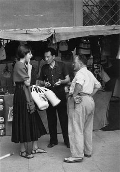 Woman buying bags in 1950 Piazza