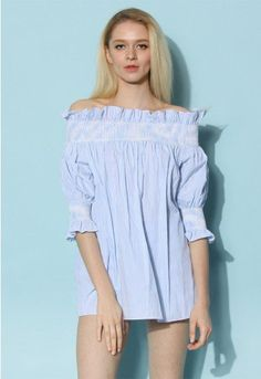 Clad in this blue-and-white striped tunic, you are off to a fresh start of a beautiful day ahead! Sassed up with a ruffle trimmed elastic shoulder, a pleated bodice, and cute puffy sleeves, this lovely striped wonder is a sign of stylish times in your past, present, and future.  - Elastic off-shoulder - Elastic cuffs - Not lined - 100% Cotton - Machine wash gently  Size(cm) Length Bust Sleeves Free      65   Free   30 Size(inch) Length Bust Sleeves Free      25.5  …