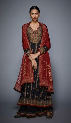 Featuring a black kurta in rayon crepe base with aari hand embroidery and full sleeves. It is paired with matching palazzo pants and dupatta. FIT: Fitted at bust and waist. CARE: Professional dry clean only. Desi Wedding Dresses, Pakistani Bridal Dresses, Fashion Models, Suit Fashion, Fashion Dresses, Ritu Kumar Suits, Classy Suits, Nice Suits, Work Suits