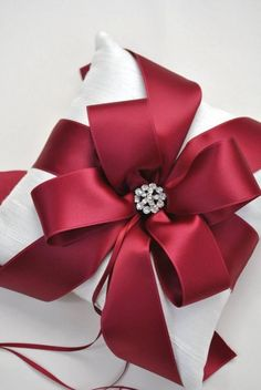 Weddbook is a content discovery engine mostly specialized on wedding concept. You can collect images, videos or articles you discovered organize them, add your own ideas to your collections and share with other people | Red satin bow #wrapping #christmas