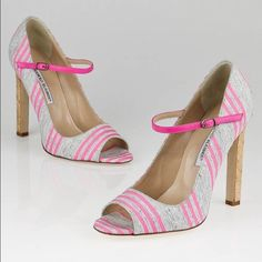 """Manolo Blahnik Pink/Grey Striped Open Toe Heels Feel fun and flirty with these Manolo Blahnik Pink/Grey Striped Canvas Open Toe Heels. 100% authentic! They have unique hot pink and heather grey striped canvas uppers with a hot pink ankle strap and a stacked cork heel. Perfect for any fun-loving fashionista with a flare for unique shoes! Excellent condition - worn only once! Heel Height: 4.5"""". Size 38.5 (these would fit an 8). No box or dustbag included. Manolo Blahnik Shoes Heels"""