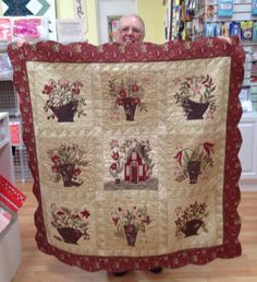 "This is Ann and her gorgeous quilt! The pattern is from the Blackbird Design book ""Quilting the Garden"" by Barb & Alma Adams, and Ann used a beautiful selection of William Morris inspired fabrics! She also does exquisite hand applique work! And I love the scalloped border!"