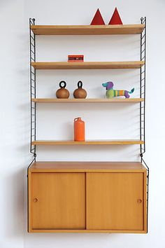 String Regal bokhyllan the ladders shelf string regal light teak wall unit