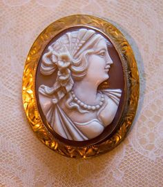 """Beautiful High relief Antique Artisan carved shell #cameo that has all the hallmarks of master craftsmen. This cameo is set in a wide hand stamped style #10k gold frame which has a pin clasp and also a loop to accommodate a chain so it can be worn as a pendant as well. Back is stamped 10k, length is 1,78"""" inches, weight is 11.2 grams."""