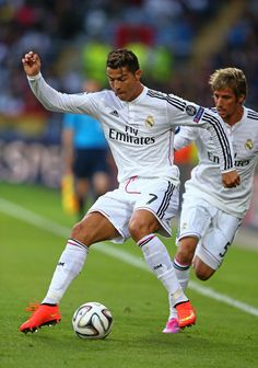 Cristiano Ronaldo of Real Madrid controls the ball during the UEFA Super Cup between Real Madrid and Sevilla FC at Cardiff City Stadium on August 12, 2014 in Cardiff, Wales.