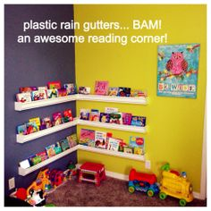 reading corner with cushioned benches at bottom shelf level, storeage under benches