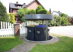 Absenkbare Mülltonnen im Vorgarten.