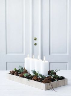 christmas inspiration A Minimalist Christmas: 12 Understated (But Still Gorgeous) Decorating Ideas Minimalist/Maximalist Christmas Candle Decorations, Scandinavian Christmas Decorations, Advent Candles, Christmas Candles, Winter Decorations, Table Decorations, Modern Christmas Decor, Christmas Design, Christmas Decorations For Apartment