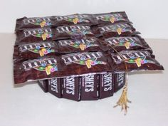 Grad hat candy cake. (Use a tin for the base?). Fill with nuggets or mini candy bars that have msgs like these: http://www.ourpartyplace.com/Nugget-Candy-Wrappers_c_45.html OR fill with kisses that have printable kiss labels with graduation messages (http://www.etsy.com/listing/118780397/instant-download-printable-2013-kiss?utm_campaign=Share_medium=PageTools_source=Pinterest )