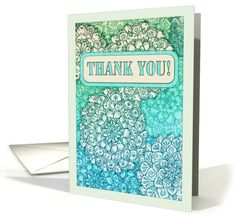 Detailed hand drawn floral mandala zentangle doodles decorate this thank you card, in shades of blue, aqua, turquoise, emerald green, mint and cream, with stencil style typography on a banner. Perfect for any occasion where you need to let someone know you appreciate them or to send thanks.