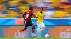 Brazil's Neymar attempts to dribble past Colombia's Juan Zuniga