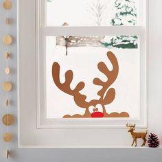 peeping reindeer window sticker by nutmeg | notonthehighstreet.com