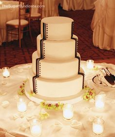 This is a simple, sophisticated way to tie a classic wedding cake into your Great Gatsby theme.   Art Deco Wedding Cake by The Sugar Syndicate, via Flickr
