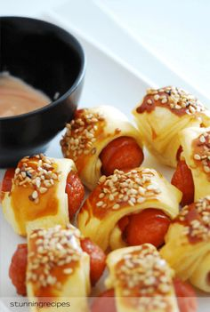 Throwing a '70s themed party? Pass around plenty of hors d'oeuvre classics like pigs in a blanket.