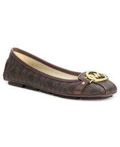 f457600cb0a A dramatic designer logo at the toe of Michael Michael Kors  Saffiano moc  flats makes