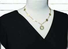Choose the right necklace for a v neck top.