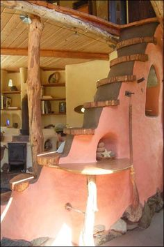 Dragonfly Cob Cottage by Meka Bunch. Staircase with niches. Wolf's Creek, Oregon