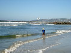 child playing in ocean
