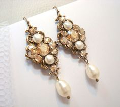 Vintage bridal earrings, wedding earrings with Swarovski golden shadow crystal and ivory pearls, antique brass, wedding jewelry. $50.00, via Etsy.