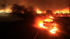 A car is engulfed in flames as the Valley fire leaps Highway 29 in Middletown, Calif.   http://www.latimes.com/local/lanow/la-butte-fire-containment-grows-20150912-story.html
