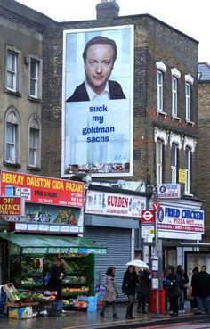 Outdoor hanging poster Suck my Goldman Sachs featuring David Cameron