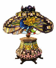 <br><li>Lamp handcrafted using methods first developed by Louis Comfort Tiffany<li>Contains 1010 pieces of stained glass, each hand-cut and wrapped in fine copper foil<li>Highlighted by 80 vibrant cabochon accents