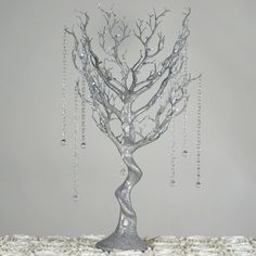 Battery Operated Glittered Silver Manzanita Tree Centerpiece For Wedding Party Event Table Top Decoration With LED Lights + 8pcs Acrylic Chains | Add some WOW factor into your wedding decor in stunning and whimsical manner by using our marvelous Vogue Manzanita Centerpiece Tree with LED lights. Placed atop your reception tables, these strikingly-beautiful Manzanita trees will impart a voguish influence to your events ambiance, leaving your guests absolutely mesmerized at the quirky appeal of…