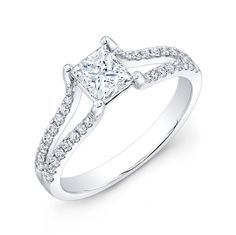 ENG-5608 - This 18KT white gold engagement ring features a split shank design with 0.28PTS of 40 prong-set round diamonds. The simple yet elegant piece is set with a 0.72PT princess-cut diamond center stone.