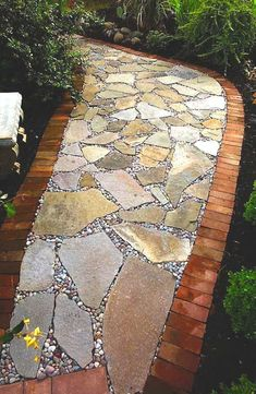 five categories of stone used in hardscape projects Flagstone path, lined with brick and filled in with river gravel.Flagstone path, lined with brick and filled in with river gravel. Flagstone Pathway, Stone Walkway, Flagstone Patio, Backyard Patio, Backyard Landscaping, Patio Stone, Concrete Patio, Patio Table, Walkways