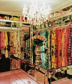 Paris Hilton's rich walk-in closet includes a mirrored chest island, pink rug and crystal chandelier.