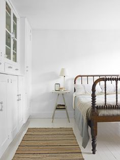 This guest room felt complete with little more than a mid-1800s spindle bed.