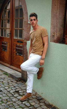 Shop this look for $84:  http://lookastic.com/men/looks/tan-crew-neck-t-shirt-and-white-chinos-and-tan-suede-desert-boots/3315  — Tan Crew-neck T-shirt  — White Chinos  — Tan Suede Desert Boots