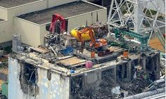The effects of the tsunami on the building containing Fukushima Daiichi's reactor three. Photograph: Kyodo/Reuters
