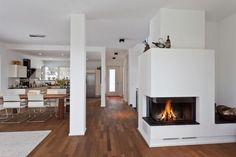Decoration, Modern Corner Fireplace Electric Gas Models Built In White Wall Panels As Well As Wooden Floors With Two White Indoor Pillars And White Living Rugs As Inspiring Interior Furniture White Living Room Ideas: Magnificent Corner Fireplace Design from Assorted Materials Beautiful Pics