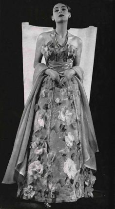 Model in elegant dress by Jacques Fath, 1952