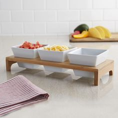 Display and serve your favourite condiments or dips in our Bamboo Triple Dish Stand. The three white ceramic dishes sit snugly in the eco-friendly bamboo stand, perfect for cocktail parties, buffets or pre-dinner appetizers.