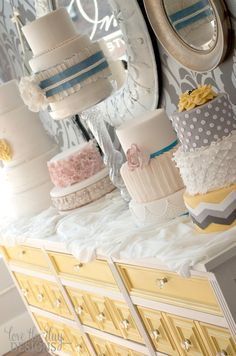 I like this idea for displaying Mari's and Renee's pastries and cake...a vintage looking shop! and i luv the dresser type table!!