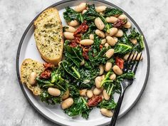 A plate full of Sun Dried Tomato, Kale, and White Bean Skillet with garlic bread food clean eating food healthy food ideas food photography food plan food recipes Healthy Chicken Recipes, Veggie Recipes, Healthy Dinner Recipes, Whole Food Recipes, Vegetarian Recipes, Cooking Recipes, Beans Recipes, White Bean Recipes, Vegetarian Barbecue