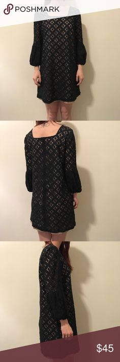 Anna Sui Anthropologie Black Eyelet Shift Dress Anthropologie Anna Sui dress in black with an Eyelet body and has tan lining underneath. Shift style and has long neatly gathered sleeves and is a size 2! In excellent condition! Anna Sui Dresses Long Sleeve