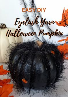 Use an inexpensive dollar store foam pumpkin, black paint, and eyelash yarn to create a fun fuzzy Halloween pumpkin. #halloween #halloweendecor #halloweencraft #dollarstorecraft #blackpumpkin #easycraft Dollar Store Halloween, Dollar Store Crafts, Easy Halloween, Halloween Crafts, Halloween Decorations, Halloween Flowers, Halloween Pumpkins, Fun Crafts, Crafts For Kids