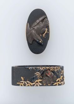 Fuchi-kashira with designs of eagle, and monkeys sheltering under a tree. Edo period early to mid-19th century - Omori Terutoshi (Japanese, about 1850) http://www.mfa.org/collections/object/fuchi-kashira-with-designs-of-eagle-and-monkeys-and-young-sheltering-under-a-tree-12496