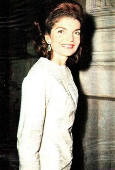 Jackie wearing the emerald earrings given to her by JFK