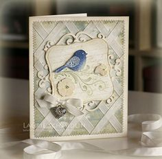 SU Stamps: Wings of Friendship, En Francais (Stampin' Up!)   Paper: Vintage Cream (PTI), K & Co Blue Awning patterned paper   Ink: Versamagic Dew Drops, Creamy Caramel, Antique Linen Distress ink   Other: Labels One Nestabilities, Cuttlebug Dies, Vanilla taffeta ribbon, Pearls, Rhinestones, Charm, Sewing Machine.