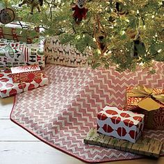 Dobby-loomed skirt stripes creamy cotton with soft chevrons composed of tiny red squares, adding softly defined pattern and color to your tree display.