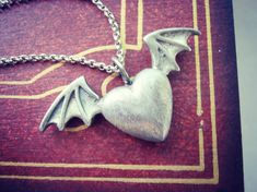 Angel Devil Heart necklace  Heart with bat wings  by FoxInTheBox, $25.00