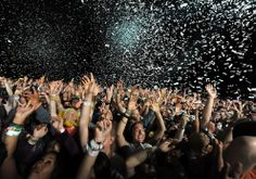 Coachella music fans dance as DJ Girl Talk (aka Gregg Michael Gillis) performs during Day 3 of the 2012 Coachella Valley Music and Arts Festival. (Frazer Harrison/Getty Images) #
