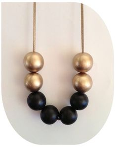 Gold and black large wooden beads long necklace by kubijewellery, $10.00